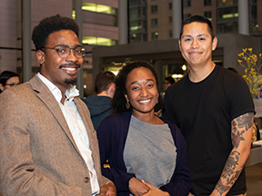 Three new Discovery Fellows pose for a photo at fall reception